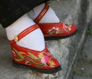 Bound feet in silk slippers